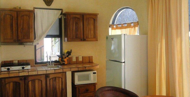 Mini kitchen with full fridge
